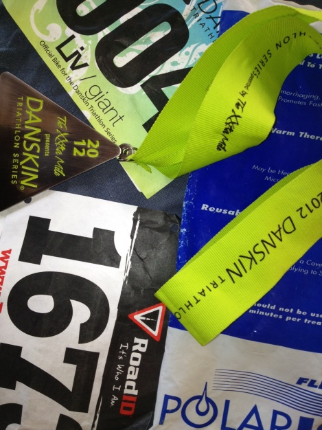 Race bibs, medals and ice pack
